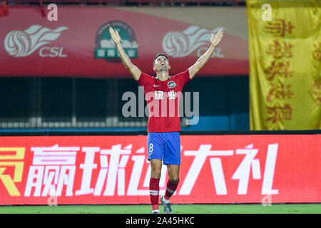 English-born Taiwanese football player Tim Chow of Henan Jianye F.C. celebrates during the 24th round match of Chinese Football Association Super Leag - Stock Photo