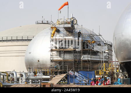 Abqaiq, Saudi Arabia. 12th Oct, 2019. EASTERN PROVINCE, SAUDI ARABIA - OCTOBER 12, 2019: A damaged object at an oil processing facility of Saudi Aramco, a Saudi Arabian state-owned oil and gas company, at the Abqaiq oil field. On 14 September 2019, two of the major Saudi oil facilities, Abqaiq and Khurais, suffered massive attacks of explosive-laden drones and cruise missiles; the Houthi movement, also known as Ansar Allah, claimed responsibility for the attacks. Stanislav Krasilnikov/TASS Credit: ITAR-TASS News Agency/Alamy Live News - Stock Photo