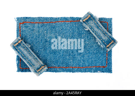 Denim fabric with two straps on a white background. Top view - Stock Photo