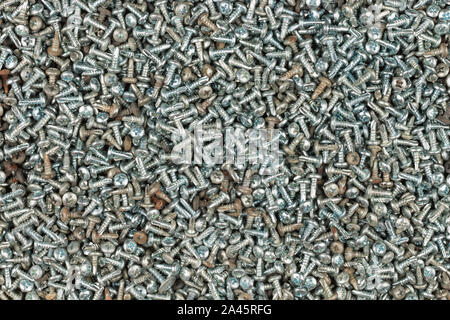 Background of screw bolts, Internal screw, bolts closeup, many screws. Industrial concept. Top view - Stock Photo