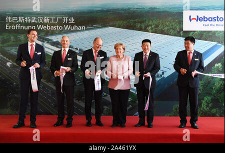 German chancellor Angela Merkel visits Webasto's new factory in Wuhan city, central China's Hubei province, 7 September 2019. - Stock Photo