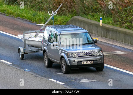 2012 GREY SILVER Land Rover Discovery XS Sdv6 Auto; UK Vehicular traffic, transport, modern, saloon cars, south-bound on the 3 lane M6 motorway highway. - Stock Photo