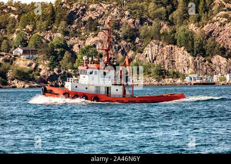 Small tug boat Lars passing Askoy (Askøy) island, outside port of Bergen, Norway - Stock Photo