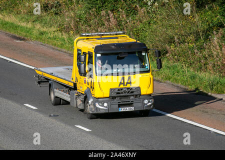2014 Renault Trucks D AA Van recovery truck. Side view of rescue breakdown recovery lorry truck transporter driving along  M6 motorway,  Lancaster, UK; Vehicular traffic, transport, modern, north-bound on the 3 lane highway. - Stock Photo