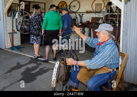 Traditional bicycle repair shop at the 2019 Goodwood Revival, Sussex, UK. - Stock Photo