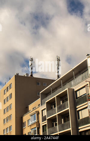 Mobile radio antennas on house roof Cologne NRW Germany - 10 12 2019 - Stock Photo