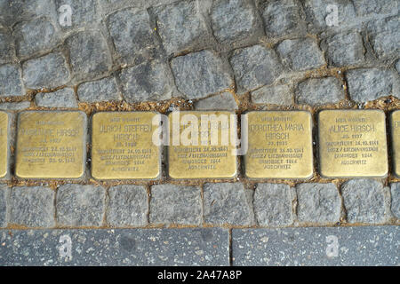 Stumbling stones of a whole family in Berlin - Stock Photo