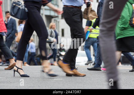 woman with high heels in pedestrian area - Stock Photo