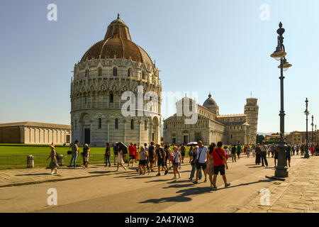Scenic view of the famous Piazza dei Miracoli square in Pisa with the Baptistery of St John, the Cathedral and the Leaning Tower, Tuscany, Italy - Stock Photo