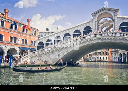 Rialto bridge and Gondola in Canal Grande river in Venice, Venezia - Italia - Stock Photo