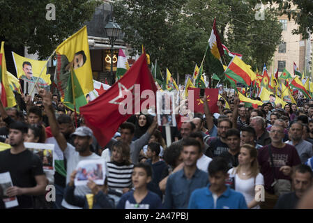 Athens, Greece. 12th Oct, 2019. Kurds living in Athens shout slogans against turkish president Erdogan as they march to the turkish embassy. Thousands Kurds took to the streets to protest, following Turkey's recent offensive against Kurdish people on northern Syria. Credit: Nikolas Georgiou/ZUMA Wire/Alamy Live News - Stock Photo