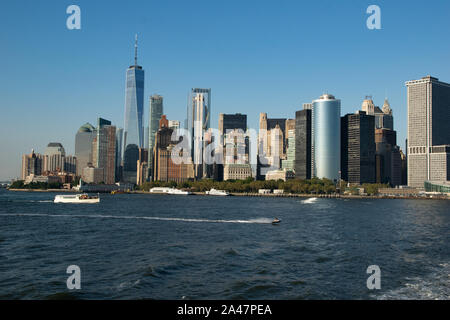 Famous view from the Staten Island Ferry towards the skyline of Lower Manhattan with Financial District and Hudson River - Stock Photo