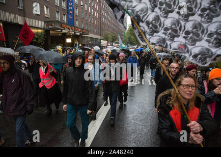 London, UK. 12 October, 2019. Climate activists from Extinction Rebellion march close to Russell Square following a funeral procession from Marble Arch on the sixth day of International Rebellion protests. Credit: Mark Kerrison/Alamy Live News - Stock Photo