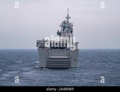 191011-N-UB406-0123  GULF OF CADIZ (Oct. 11, 2019) The Spanish navy amphibious assault ship-aircraft carrier ESPS Juan Carlos (L-61) transits the Gulf of Cadiz with NATO Allied forces as part of exercise Dynamic Mariner 2019 as seen from the U.S. Navy guided-missile destroyer USS Gridley (DDG 101). The NATO Maritime Command-led Dynamic Mariner/Flotex 19 (DYMR/FL19) is an exercise that tests NATO's Response Force Maritime Component and enhances the flexibility and interoperability amongst Allied nations. DYMR/FL19 involves ships, submarines, aircraft and personnel from fifteen Allied nations co - Stock Photo