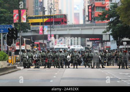 Hong Kong, China. 12th Oct, 2019. Police patrol Nathan Road during the demonstration.Another illegal masked rally after city's Chief Executive Carrie Lam announced the new anti-mask law under the emergence regulation. The legislation started on Friday, October 5th, 2019. The law has banned protesters from covering their faces in full or partially during lawful or unauthorised protests, rallies and marches. Failure to do comply with the law could result in a sentence of a year in jail and a fine of HK$25,000. Many believes once the anti-mask law come into force freedoms of expression and One Co - Stock Photo