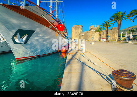Amazing travel and vacation place. Stunning promenade and harbor with boats. Medieval and historic old town with Kamerlengo castle, Trogir, Dalmatia, - Stock Photo