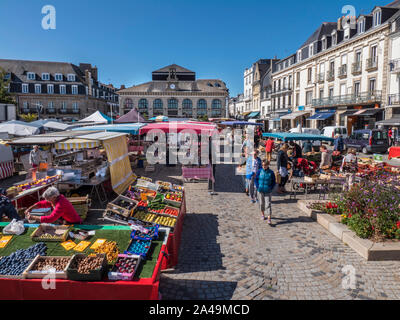 CONCARNEAU OUTDOOR MARKET Fresh French Produce on sale at  market day in square & Les Halles indoor market in background Concarneau Brittany France - Stock Photo