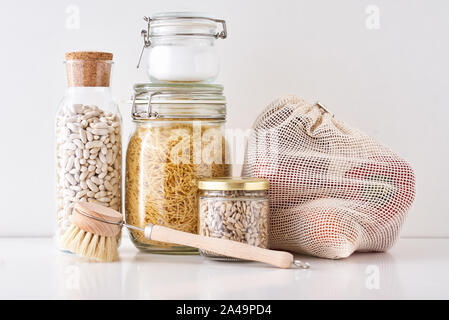 Glass jars with food ingredients on white background. Zero waste concept. Kitchen background with eco friendly utensils