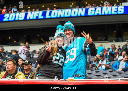 London, UK.  13 October 2019. Fans ahead of the NFL match Tampa Bay Buccaneers v Carolina Panthers at Tottenham Hotspur Stadium.  Credit: Stephen Chung / Alamy Live News - Stock Photo