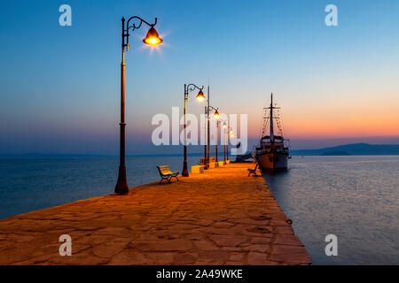 Wooden motor boat at sunrise, used for tourist trips on the sea, Pefkohori, Greece - Stock Photo