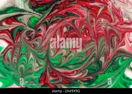 Colorful liquid paints mixed together creating modern abstract - Stock Photo