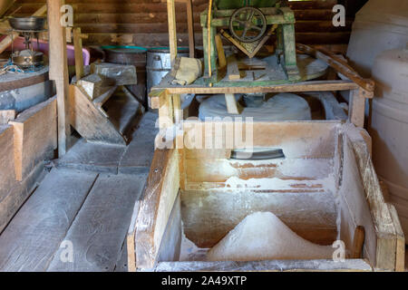 Old fashioned mill for grinding corn to flour. Water from a river flows under this mill, wooden paddles are placed in the flow to cause a rotation of - Stock Photo