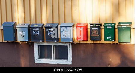 Umea, Sweden - September 15, 2019: several different mailboxes in a row - Stock Photo