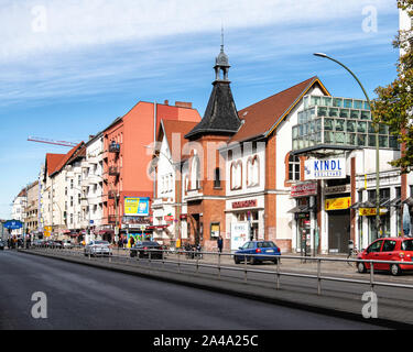 Hermannstrasse street view with shops & apartment buildings In Neukölln, Berlin. Kindl Boulevard, Woolwort store - Stock Photo