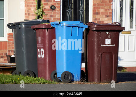various recycling wheelie bins outside houses in Liverpool England UK - Stock Photo