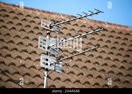 three television aerials on a pole outside a house in Liverpool England UK - Stock Photo