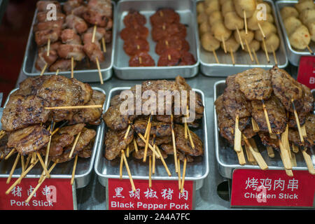 Various types of barbecue meat skewer selling at the food stall. - Stock Photo