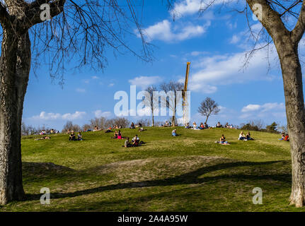 People enjoying warm and sunny spring day in Budapest City Park. - Stock Photo