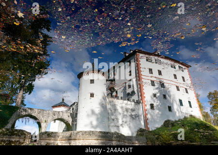 Reflection of Sneznik castle in the lake, Slovenia - Stock Photo