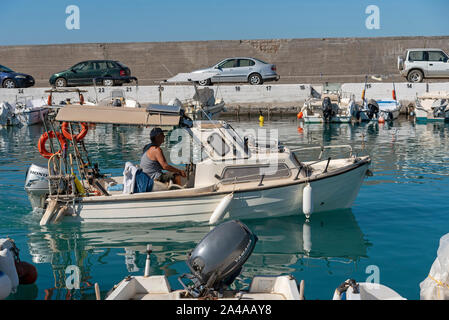 Gouves, Crete, Greece. October 2019.  Small cabin cruiser underway from the small harbour at Kato Gouves a former US military base - Stock Photo