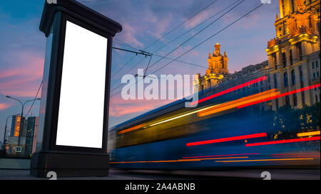 Blank vertical advertising white billboard poster or pillar - mock up image - Stock Photo