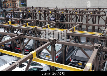 New York, USA. 08th Sep, 2019. Cars are parked on a multi-storey lifting platform in a private parking lot in the Chelsea district of Manhattan. Credit: Alexandra Schuler/dpa/Alamy Live News - Stock Photo