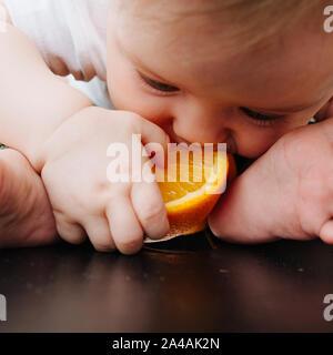 Square close-up shot, Baby gets orange juice - Stock Photo