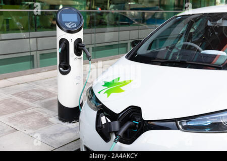 An electric car being charged at an EV charging point on a city street in Islington, London