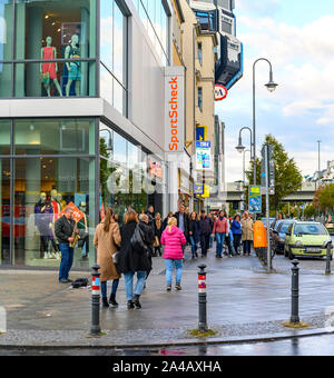 Berlin, Germany - October 5, 2019: Scene in a shopping street in Berlin-Steglitz in rainy weather. - Stock Photo