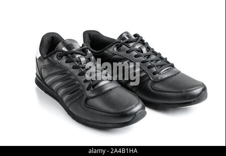Pair of black sneakers on a white background - Stock Photo