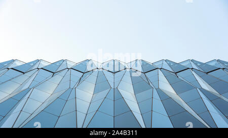 Closeup View Of Diamond Shape Curtain Walls. Clear Glass Crystal Windows Of Building. Spandrel Facade System And Sky - Stock Photo