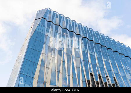 Glass Crystal Windows. Clear Glass Curtain Wall. Top of Spandrel Facade System. Corner and Parapet of Modern Building. - Stock Photo