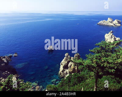 Paleokastrica beach on Corfu Kerkyra, Greece. Ionian sea. Bay with crystal clear azur water. - Stock Photo