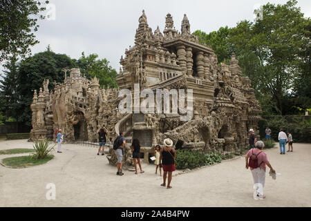 Visitors in front of the Ideal Palace (Le Palais idéal) designed by French postman Ferdinand Cheval and build from 1876 to 1912 in Hauterives, France. ATTENTION: This image is a part of a photo essay of 36 photos featuring the Ideal Palace (Le Palais idéal). - Stock Photo