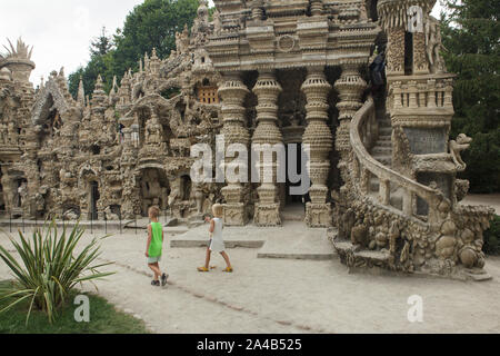 Young visitors in front of the entrance to the Ideal Palace (Le Palais idéal) designed by French postman Ferdinand Cheval and build from 1876 to 1912 in Hauterives, France. ATTENTION: This image is a part of a photo essay of 36 photos featuring the Ideal Palace (Le Palais idéal). - Stock Photo