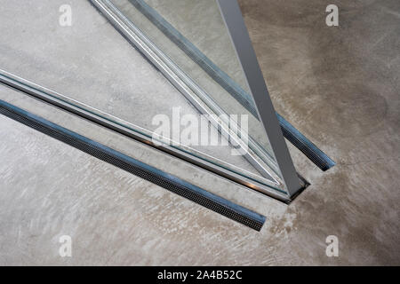 Sharp Internal Corner of Glass Curtain Wall and Windows. Inserted Radiators in the Polished Concrete Floor. - Stock Photo