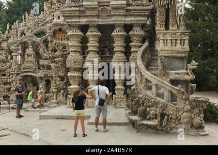 Visitors in front of the entrance to the Ideal Palace (Le Palais idéal) designed by French postman Ferdinand Cheval and build from 1876 to 1912 in Hauterives, France. ATTENTION: This image is a part of a photo essay of 36 photos featuring the Ideal Palace (Le Palais idéal). - Stock Photo