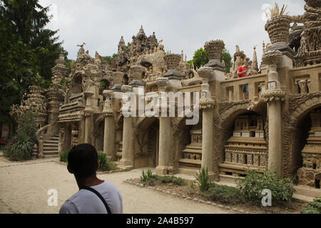 Visitor in front of the west facade of the Ideal Palace (Le Palais idéal) designed by French postman Ferdinand Cheval and build from 1876 to 1912 in Hauterives, France. ATTENTION: This image is a part of a photo essay of 36 photos featuring the Ideal Palace (Le Palais idéal). - Stock Photo