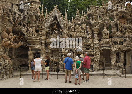 Visitors in front of the east facade of the Ideal Palace (Le Palais idéal) designed by French postman Ferdinand Cheval and build from 1876 to 1912 in Hauterives, France. ATTENTION: This image is a part of a photo essay of 36 photos featuring the Ideal Palace (Le Palais idéal). - Stock Photo