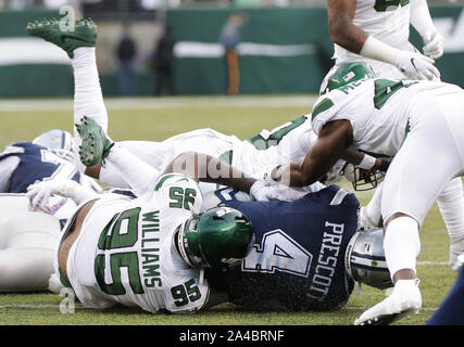 East Rutherford, United States. 13th Oct, 2019. Dallas Cowboys quarterback Dan Prescott gets sacked in the first half against the New York Jets in week 6 of the NFL season at MetLife Stadium in East Rutherford, New Jersey on Sunday October 13, 2019. Photo by John Angelillo/UPI Credit: UPI/Alamy Live News - Stock Photo